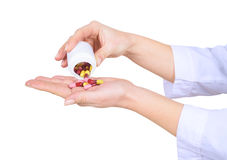 Closeup on female hands with pills Royalty Free Stock Image