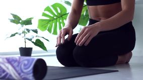 Young woman doing yoga workout at home stock video footage