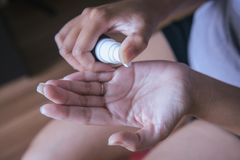 Closeup of female hands testing texture of beauty products Royalty Free Stock Images