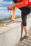 Closeup of female hands tying running shoes laces Royalty Free Stock Photos