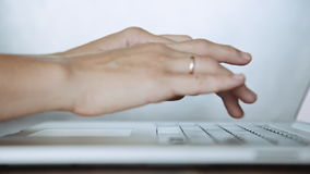 Closeup of female hands typing on laptop keyboard stock video footage