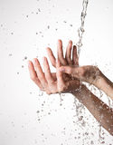 Closeup female hands under the stream of splashing water Royalty Free Stock Photos