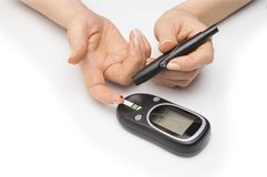 Closeup female hands using glucometer scanner on finger with blood sample. Closeup female hands using glucometer scanner on finger with blood sample stock image