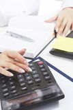 Closeup of female hands working with calculator Stock Image