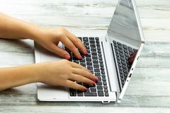 Closeup female hands of young business woman using laptop on rus stock images