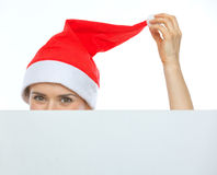 Closeup on female head in Christmas hat Royalty Free Stock Photography