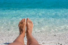 Closeup of female legs background of the turquoise Royalty Free Stock Photos
