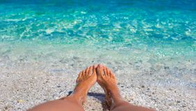 Closeup of female legs background of the turquoise Stock Photography