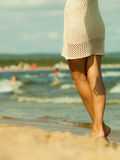 Closeup of female legs on beach Stock Photography