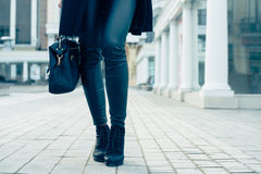 Closeup of female legs in black pants and boots Royalty Free Stock Photos