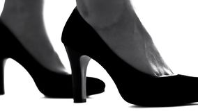 Closeup of female legs in high-heeled shoes, feminism concept, womens rights. Stock photo royalty free stock images