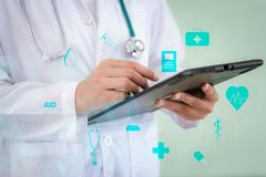 Closeup of female medicine doctor is using tablet for physical patient examination with healthcare and medical icon., Hospital and stock photo