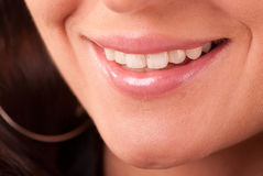 Womans teeth. Closeup of female mouth with white teeth visible Royalty Free Stock Photography