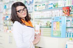 Woman pharmacist over blurred background Stock Images