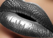 Closeup Female Plump Lips with Silver Color Makeup. Fashion Celebrate Make-up, Glitter Cosmetic. Christmas Style. Closeup Female Plump Lips with Silver Color royalty free stock photography