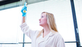Closeup of a female researcher/chemistry student Royalty Free Stock Image
