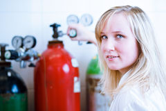 Closeup of a female researcher/chemistry student Royalty Free Stock Photography
