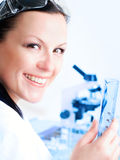 Closeup of a female researcher holding up a test t Royalty Free Stock Images