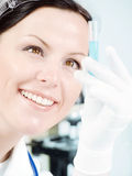 Closeup of a female researcher holding up a test t Royalty Free Stock Photography