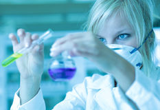 Closeup of a female researcher in a lab. Closeup of a female researcher carrying out experiments in a lab Royalty Free Stock Images