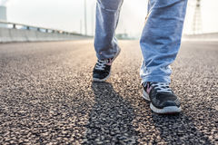 Closeup of female running on the road Stock Photo