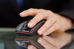 Closeup of a female's hand working on computer mouse Royalty Free Stock Image