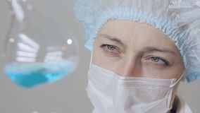 Closeup of a female scientist doctor analyzing cells of a fluid virus in a professional laboratory. Closeup of a female doctor doctor analyzing cells of a liquid stock video footage