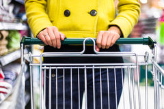 Closeup of female shopper with trolley at supermarket stock photos