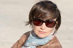 Closeup of a female in sunglasses Stock Photos