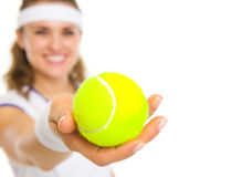 Closeup on female tennis player giving tennis ball Royalty Free Stock Image