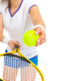 Closeup on female tennis player serving ball royalty free stock photography