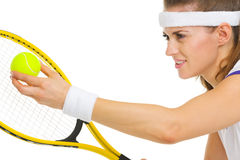 Closeup on female tennis player serving ball Royalty Free Stock Photo