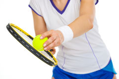 Closeup on female tennis player serving ball Royalty Free Stock Photos