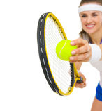 Closeup on female tennis player serving ball Stock Image