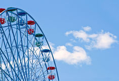 Closeup of a ferris wheel on a sunny day Stock Photos