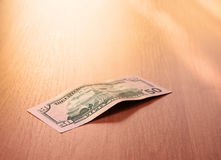 Closeup of fifty dollar bills on wooden table Stock Photography