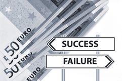 Euro gamble. Closeup of fifty euro banknotes with success failure sign Stock Photos
