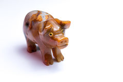 Figurine of a pig standing on a white table Stock Photo
