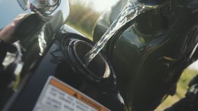 Closeup of fill gasoline motorcycle. Stock. Close-up of reflection of man in chrome detail of motorcycle. Motorcyclist stock images