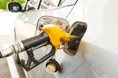 Closeup  fill the machine with fuel. Royalty Free Stock Photos
