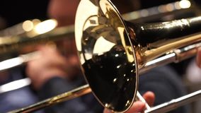 Closeup film of fragment trumpet. Instrument closeup on focus and focusless. Fragment trumpet closeup. Trumpet player jazz music. Instrument closeup on focus stock video