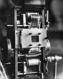 Closeup of film projector. (All persons depicted are no longer living and no estate exists. Supplier grants that there will be no model release issues royalty free stock images