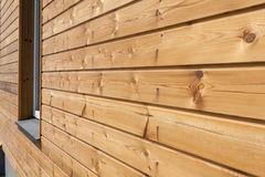 Closeup of finally slatted natural wood on house. Closeup of finally slatted natural wood on house Stock Photography
