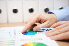 Closeup of financial consultant when  analyzing business data Royalty Free Stock Image