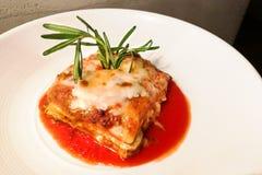 Closeup of fine dining italian lasagna. Served on elegant style Royalty Free Stock Photo