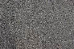 Closeup of the surface of fine gravel. Closeup of fine, grey gravel made up of small, sharply faceted crushed stone Stock Photography