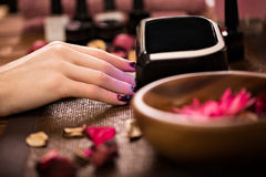 Closeup finger nail care by manicure specialist in beauty salon. Royalty Free Stock Image