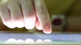 Closeup finger touching tablet computer touchscreen stock video footage