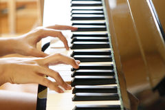 Closeup of fingers playing piano Royalty Free Stock Photos
