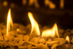 Closeup of fire flames in a chimney Stock Photos